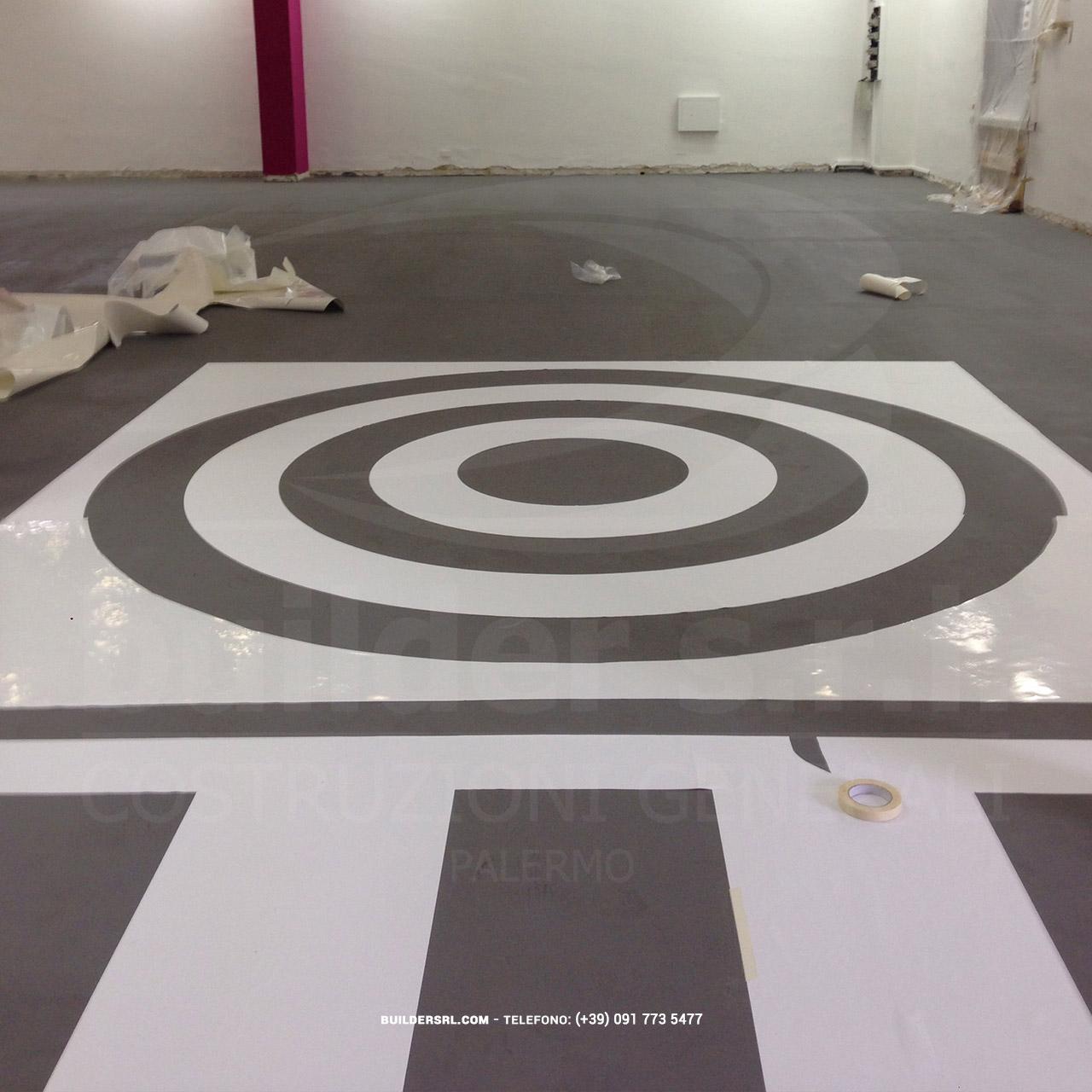 Posa di adesivi in PVC. - Realizzazione di forme geometriche nella pavimentazione.