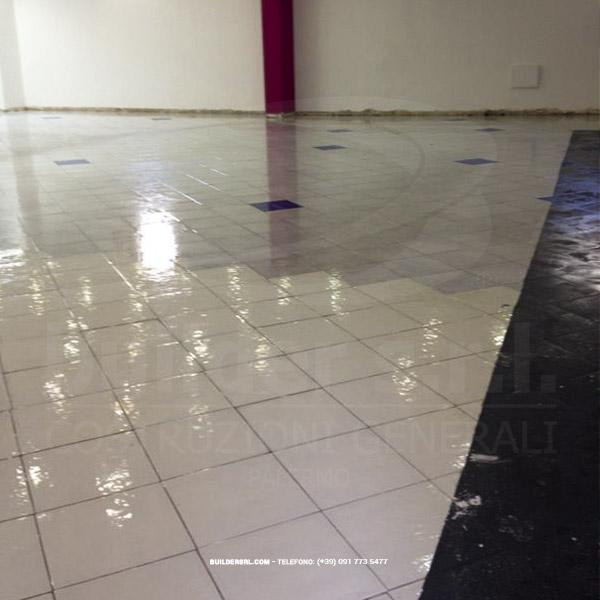 Trattamento della pavimentazione esistente - con l'ausilio della soda caustica.